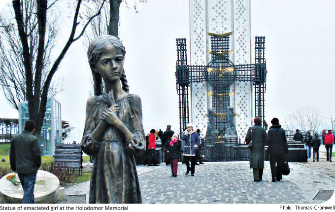 Statue of emaciated girl at the Holodomor Memorial